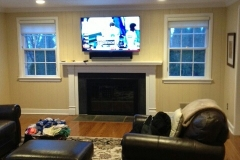 living room tv above fireplace